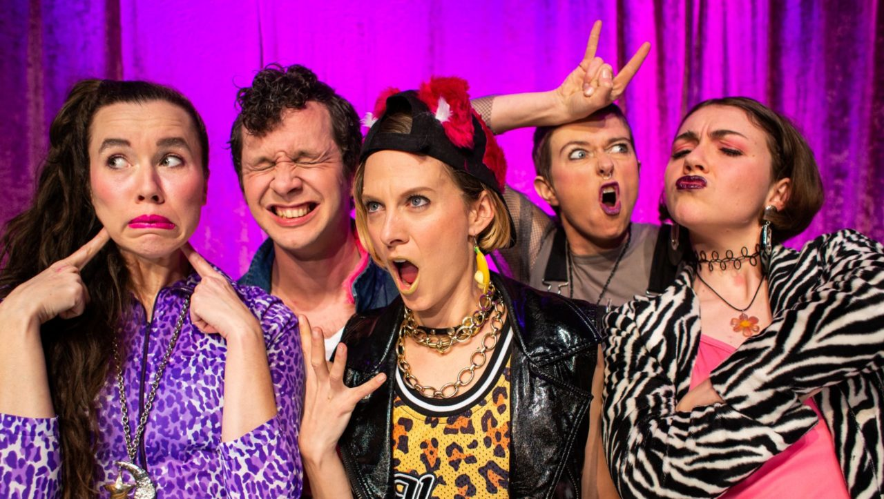 five people pulling faces with bright and patterned costumes on