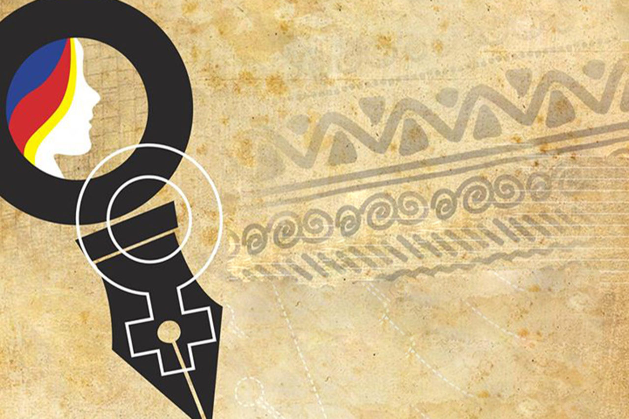 The nib of a female pen on an indigenous cultural design