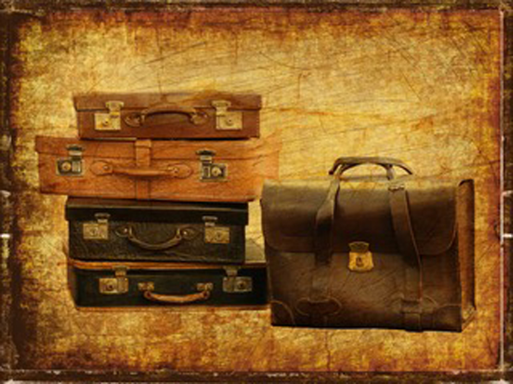 A stack of suitcases on a brown background