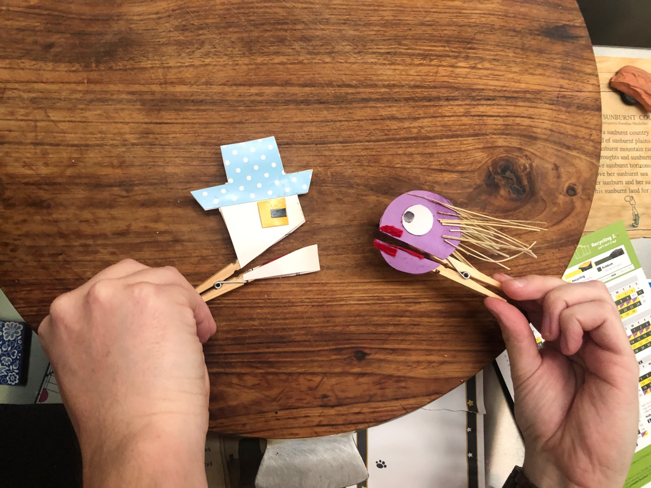 Two clothes peg puppets