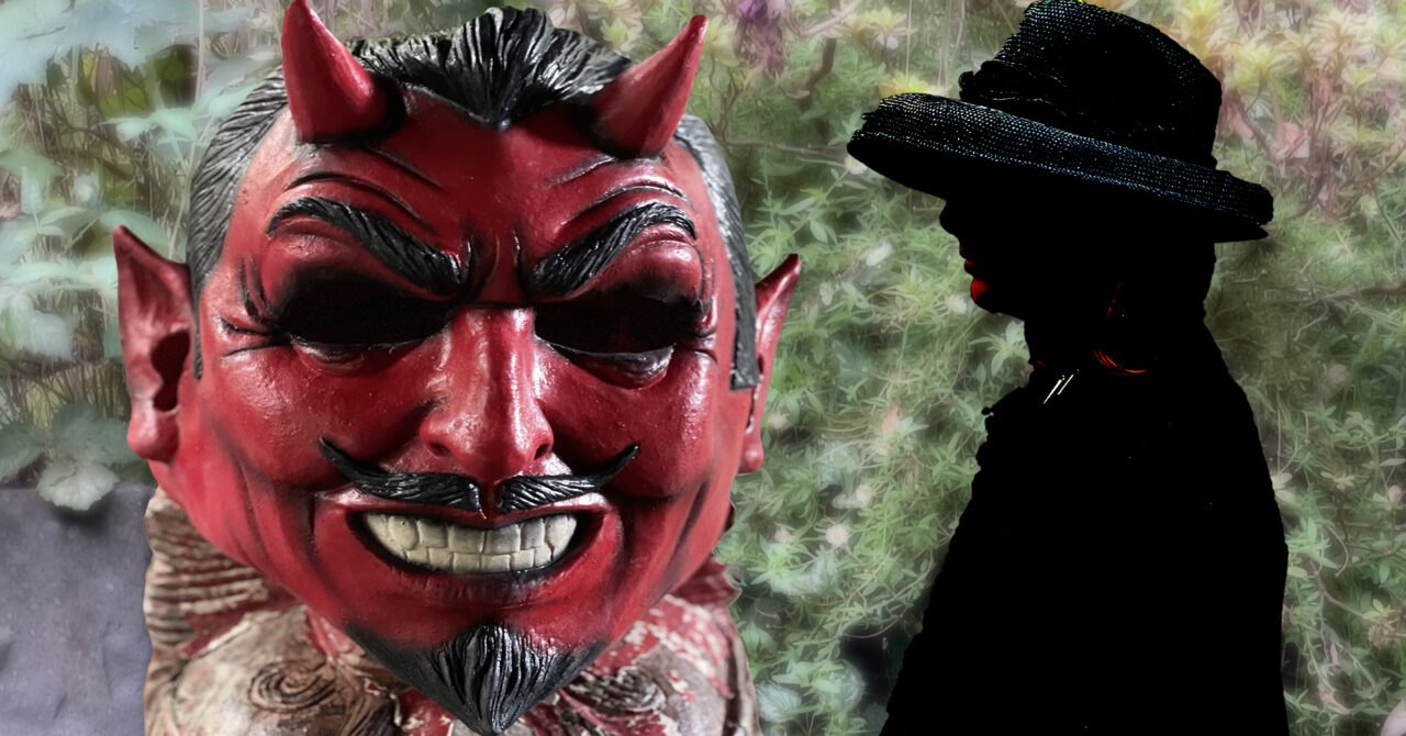 A red devil mask in foreground and a woman in sillhouette against a rural backdrop.