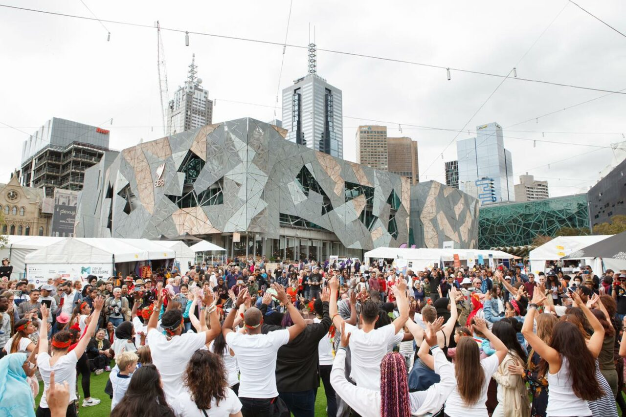 A flash mob of dancers at Federation Square